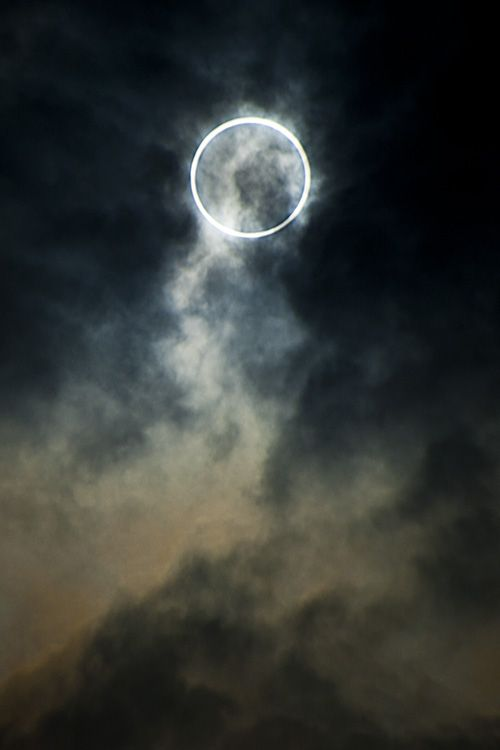 In 1999 I saw a total solar eclipse with my family and our dog, from a hill behind the house where I grew up in Devon. It being the highest point for miles around there were lots of other people from the village on the hill (normally deserted) wearing protective glasses. Even a local farmers wife/ white witch doing some kind of spells. A very surreal day. This is not that eclipse but a nice image.