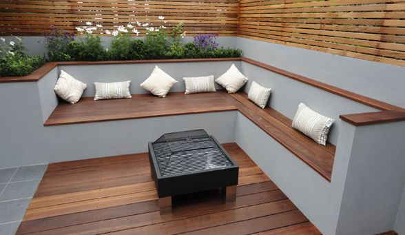 Contemporary Bench that utilises a mix of materials and texture with high gloss on the wood offset with a Matt concrete finish and in the center gather round a beautiful fire pit.