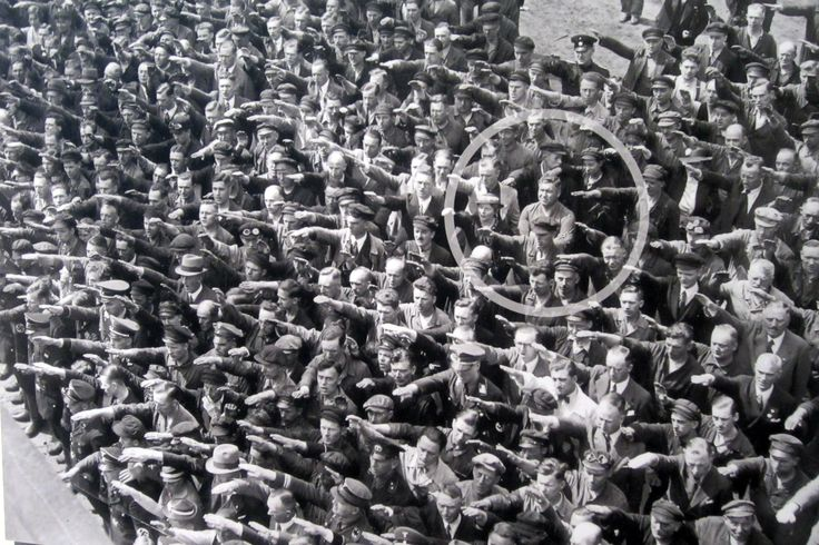 The famous photograph in which an unidentified man, claimed to be August Landmesser, refused to give the Nazi salute.