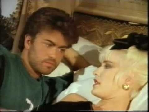 In bed with GEORGE MICHAEL...Love how sweet and shy George is during this interview