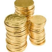 """Purchase plastic or chocolate gold coins and hide them all over the party area. Give each child a Mario-themed favor bag. When you say, """"go,"""" the children have to find as many gold coins as they can. The player who finds the most gold coins wins the game. All players can keep their gold coins to take home as a party favor."""