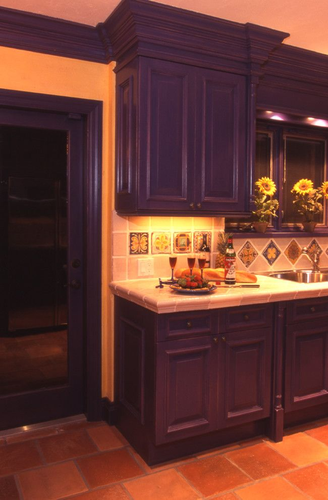 custom Mediterranean kitchen idea with deep purple cabinets printed tiles backsplash clay burnt tiles floors of 50 Inspiring Purple Theme Colour for Kitchen