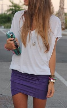 tight coloured skirts with a loose tee and lots of bracelets