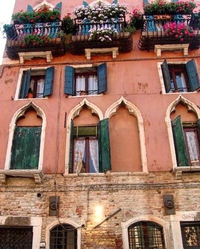 🇮🇹Cute shutters in Venice. Love the colour and vibrancy of these Venetian homes 💛💚💙💜❤️ #visititalia #venice  #thatview #venezia  #italy #vibrant #picturesque #beautiful #colourful #window #shutters  #architecture #buildings #scenery #visitveneto #melbournelifelovetravel #instatravel #instamoments #gondolaride #travel #potplants #venetianhomes #home