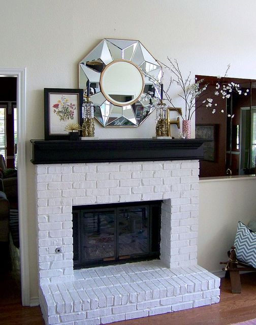 okay white mantel white wood surround maybe porcelain tile inside edge and slate on top of outside hearth
