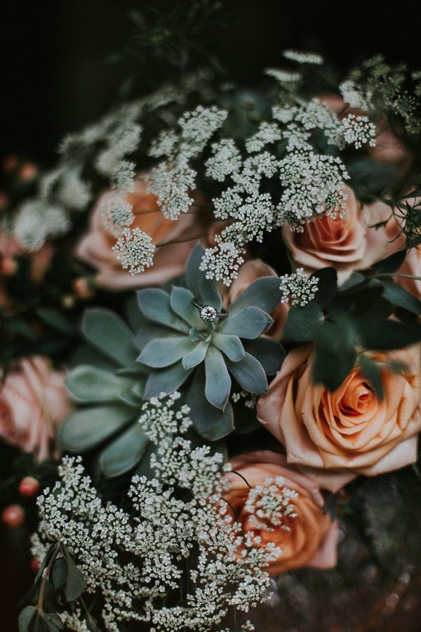Succulent, coral rose, and baby's  breath wedding bouquet | Image by Katelyn Shanice Photography