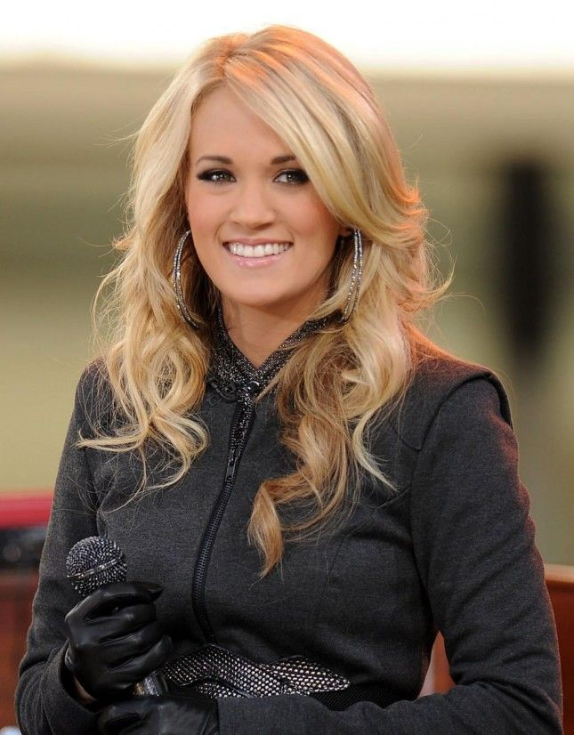 Give your hair bounce + height like Carrie Underwood by getting a long, layered haircut.