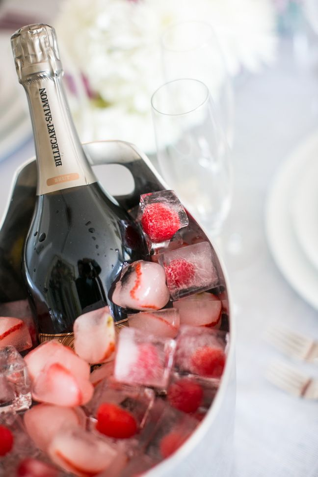 Champagne on ice-cubes filled with raspberries and strawberry. I would try lychees too...yum! #valentinesday