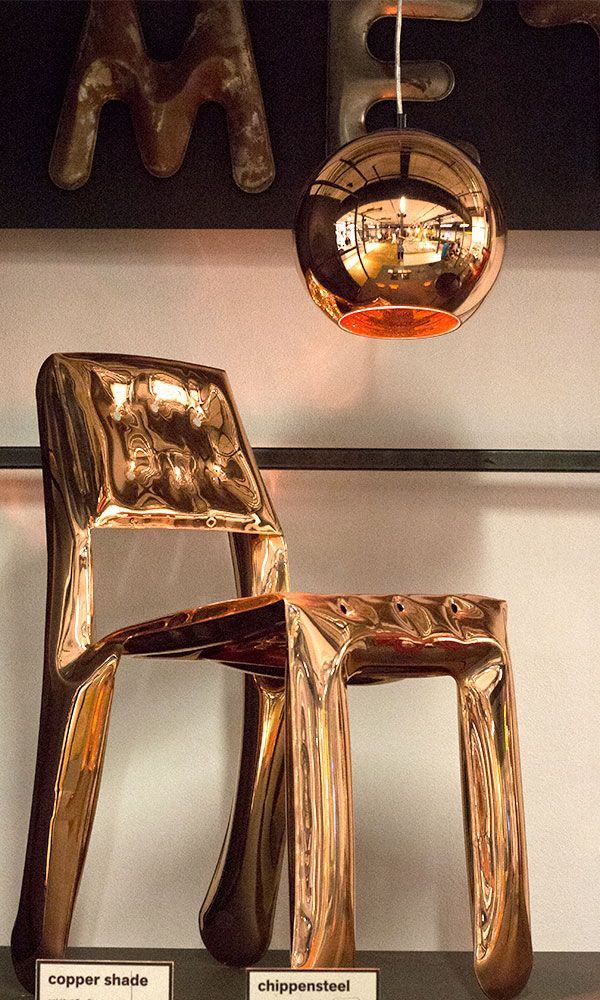 Oskar Zieta's Plopp Chair (an iteration of the iconic Plopp Stool) alongside British designer Tom Dixon's pendant lights