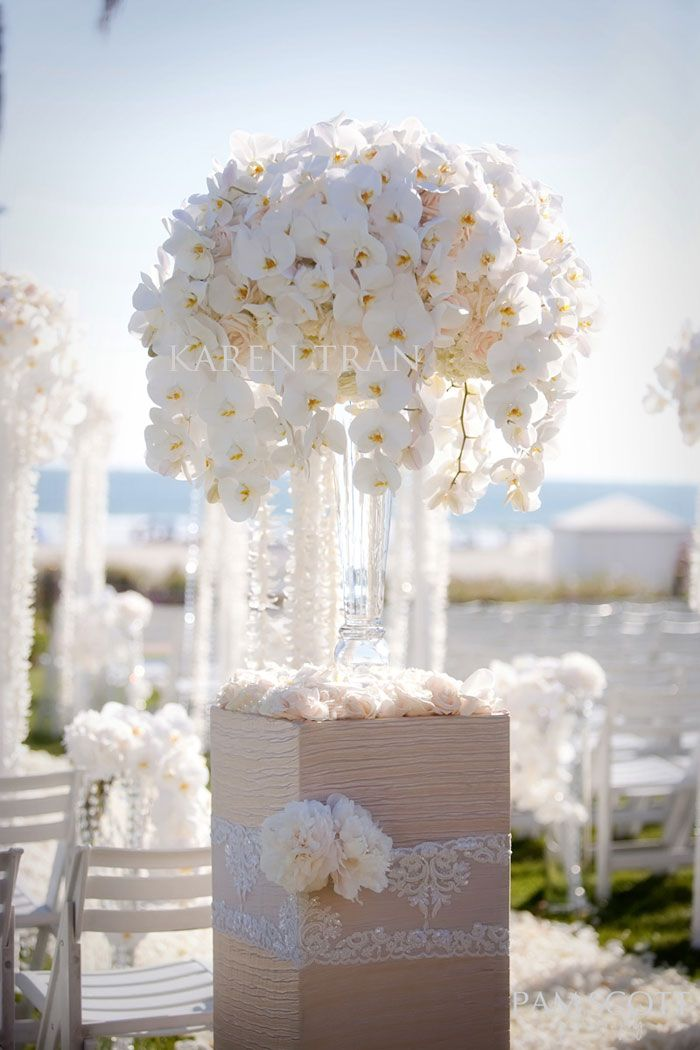 Orchids and peonies by @Karen Tran for a white wedding ceremony at Four Seasons Resort Maui
