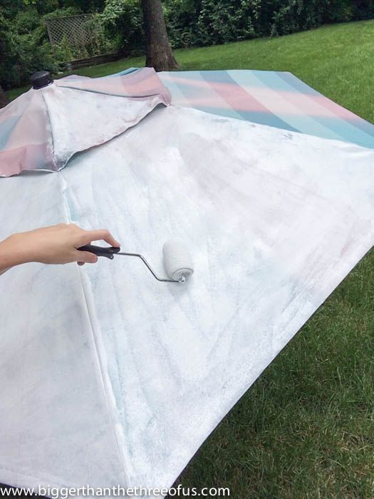 Painting an outdoor umbrella with a roller--ended up using paint sprayer