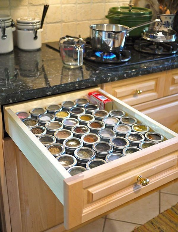 Store spices in drawers but make sure you organize them nicely. Put them in rows and, if there's some space left, fill it with a box or something else to prevent the spice jars for rolling around.