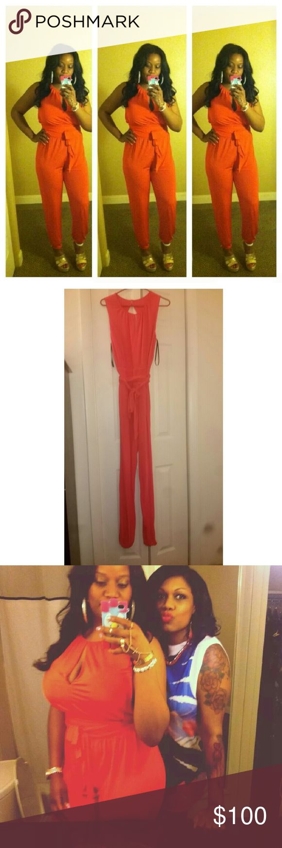 Coral Jumpsuit Delicate fabric. Bright color. High neck neckline with keyhole. Ties around the waist. Gets tighter around the ankle. Only wore this jumpsuit once! bebe Pants Jumpsuits & Rompers