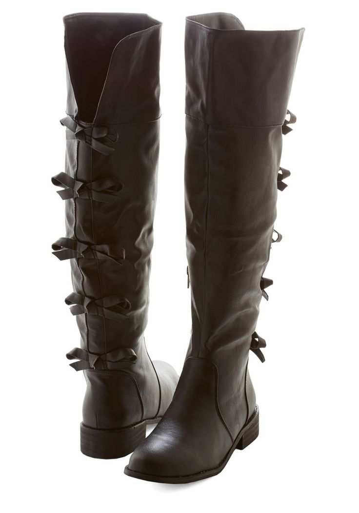 A Row of Bows Boot. Line up these bow-adorned riding boots with a plethora of ensembles! #black #modcloth