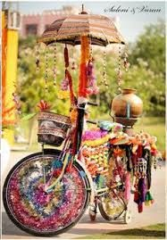 Fun Indian wedding decorations - Look at this brightly decorated cycle!