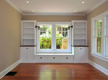 Could build something like this around window in guest room. could accommodate either the window seat or a desk in this area.  Craftsman Renovations traditional
