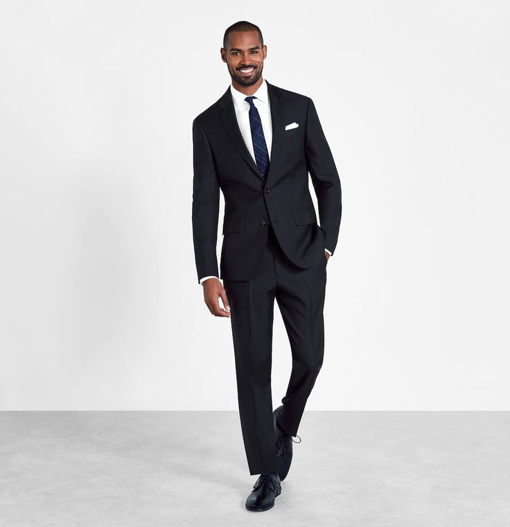 Our black suit is perfect for when the event is too formal for a colorful suit but a full-on tux is too much. Online suit rentals from The Black Tux.