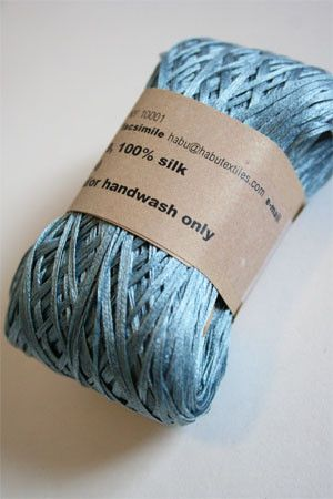 Gorgeous hand dyed silk ribbon is fingering/novelty - crisp yet soft, this is a wonderful ribbon type yarn that adds interest and texture.                                                                                                                                                     More
