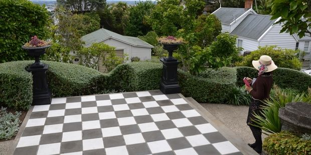 This garden perched on the side of Mt Eden, designed by Trish Bartleet, features a sculptural Teucrium fruticans hedge. Photo / Meg Liptrot