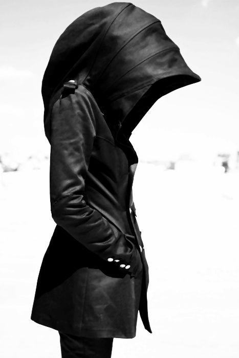 It's a hoodella or umbrodie.  Hoodie jacket with built in umbrella, :)