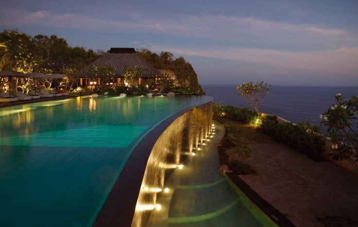 Guests would be served cocktails along the cliff-side pool, which would be blanketed with floating petals.   #BulgariResortBaliEscape