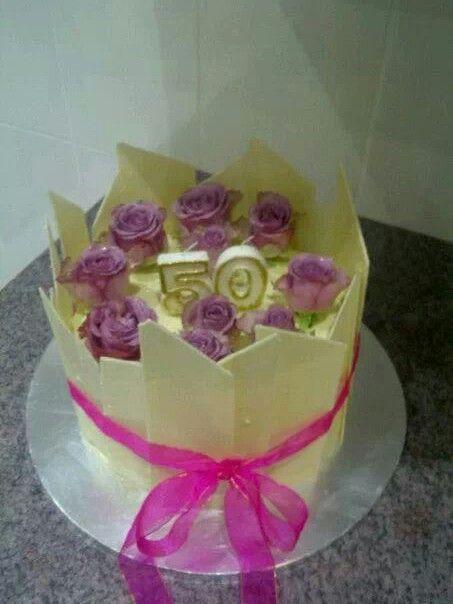 50th Birthday cake. White chocolate shards and fresh roses.