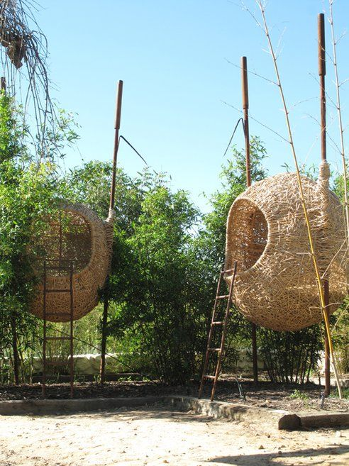 an amazing human-sized beautiful nests that biomimic shelters that weaver birds build by South African design company Animal Farm's Porky Heferall