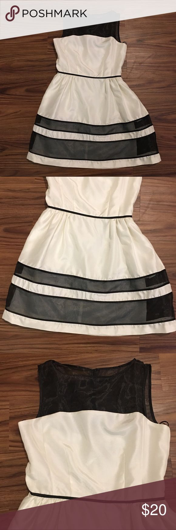 Formal black and white dress size 6 Formal dress. White with black stripes. Zipper back. Sleeveless. Never worn. Lining underneath. Size 6. Dresses Midi