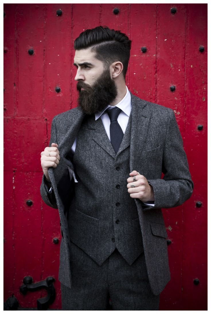 Shop this look on Lookastic:  http://lookastic.com/men/looks/blazer-and-waistcoat-and-dress-pants-and-dress-shirt-and-tie/609  — Charcoal Wool Blazer  — Charcoal Wool Waistcoat  — Charcoal Wool Dress Pants  — White Dress Shirt  — Black Polka Dot Tie