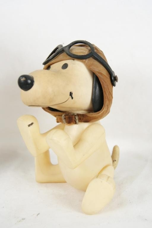 Vintage Snoopy Toy.  I still have the one we had when we were children.