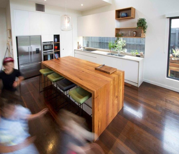 Recycled Messmate Kitchen Island bench with waterfall ends. Follow us on Instagram @timberrevival or visit our website for more information http://www.timberrevival.com.au.    #recycledtimber #recycledmessmate #timberbenchtop #waterfalledge #doublewaterfall #kitchenisland #timberislandbench