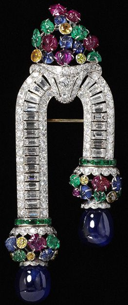 Brooch. possibly Van Cleef & Arpels, about 1930 Platinum and gold set with baguette- and brilliant-cut yellow diamonds, emeralds, sapphires and rubies  © Victoria & Albert Museum, London
