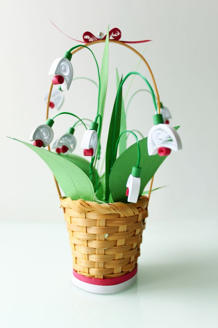 A combination of origami and quilling technique for making spring Lilly of the Valley flowers.