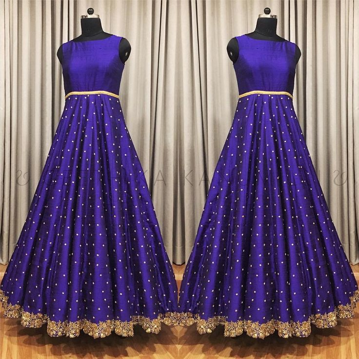 Ethnic blue sleveless anarkali with gold cut work border embroidered on it and aari work all over the anarkali dress. 03 December 2017