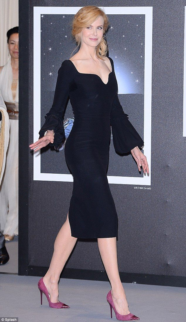 Wow: what a stunner xx Nicole paired the figure-hugging number with bright mauve shoes and a black bow in her loosely styled hair