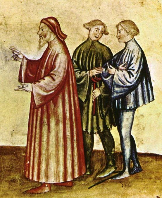 Older man wears a long, loose houppelande. The fashionable young men wear short tunics, one with dagged edges. The man on the right wears shoes with long pointed toes, late 14th century.