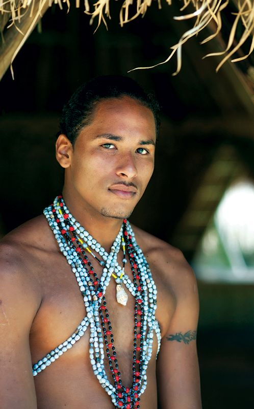 A proud member of Dominica's Kalinago tribe.Carib Indian.They live on the east coast o Dominica, Cabribean Island