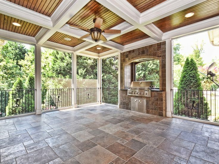 Screened Porch with Coffered Ceilings, Exterior Ceiling Fan, Beautifully Tiled Built In 6 Burner Rotisserie Grill with Industrial Exhaust.