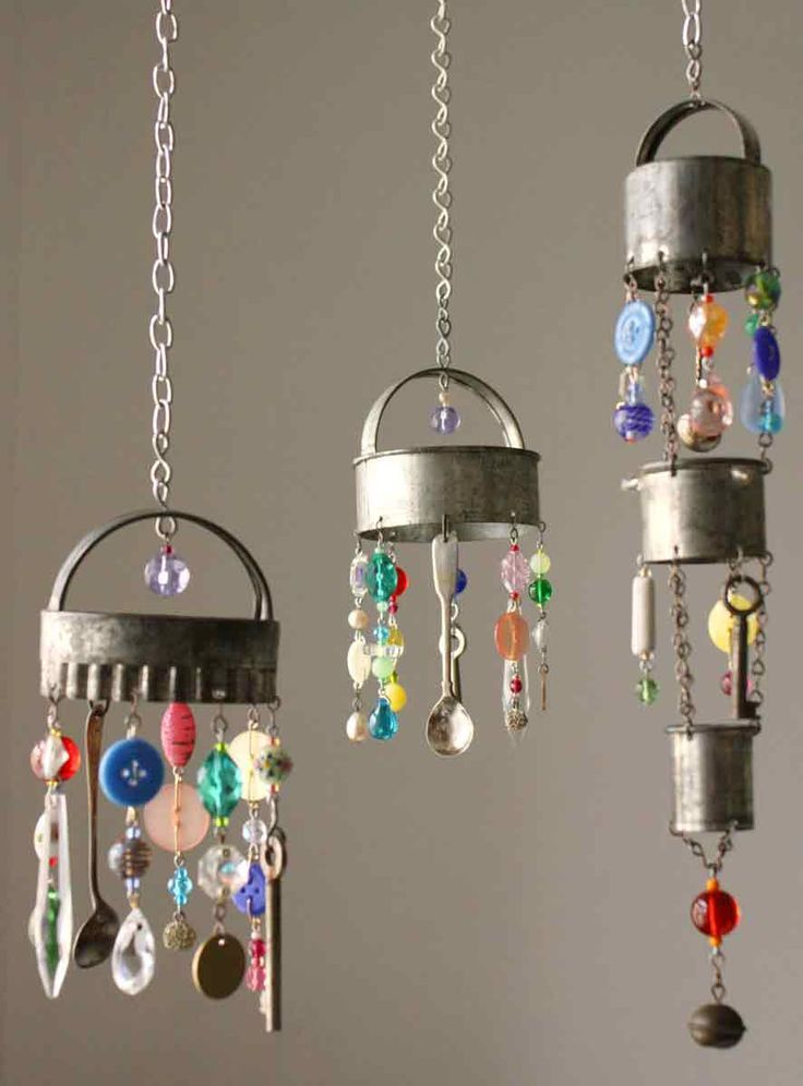 Wind chimes made from old cookie cutters, plastic beads & buttons, and teaspoons