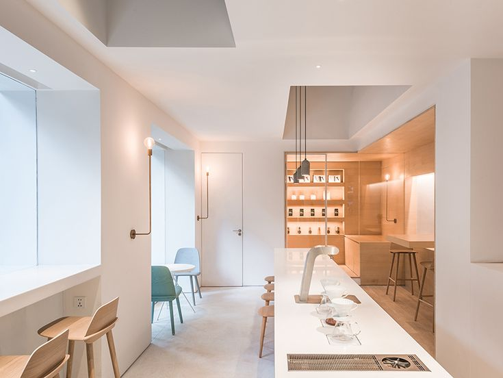 lukstudio has revived an corner lot in a residential district of guangzhou, china, into a café and coworking space defined by several shapely white volumes.