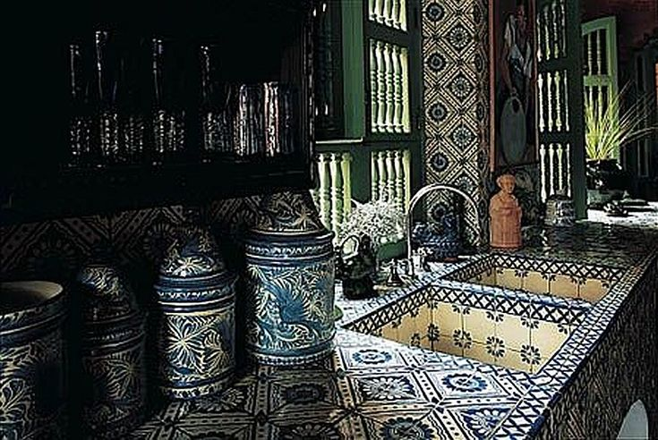 Blue and white Mexican tile and canisters add so much character to this kitchen