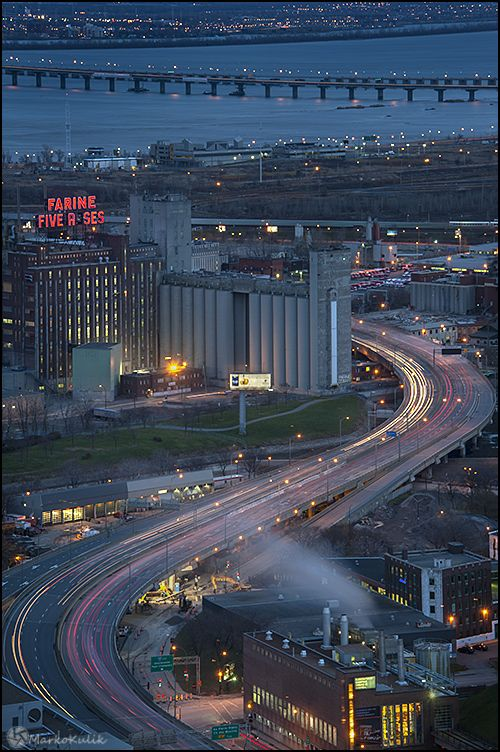 This photo was taken from a high floor in the Old stock Exchange building in Montreal during the blue hour.