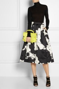 Somewhere between a mini and a maxi, midi-skirts have swished into stores and are grazing the shins of fashionistas everywhere. Here's how to rock this trend right through summer. http://vitamindaily.com/canada/skirt-the-issue-1.1007942