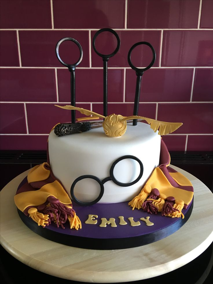 Harry Potter themed cake with Quidditch rings, snitch, scarf and glasses