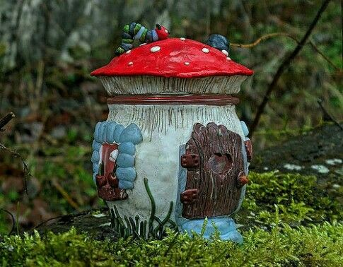 Villa Toadstool-made of an empty marmalade jar and polymer clay.