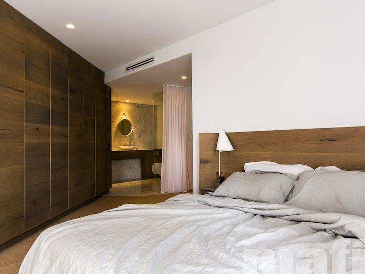 Floor to ceiling timber wardrobes and bedhead designed by C+M Studio using mafi Oak Country Brushed Grey Oil.