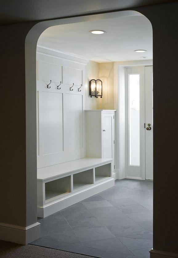 Slate tile mudroom by Cameo Homes Inc.