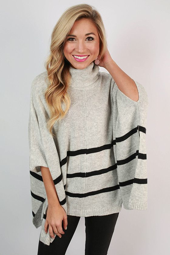 This poncho is on point! We love the stripes and the lightweight fabric.