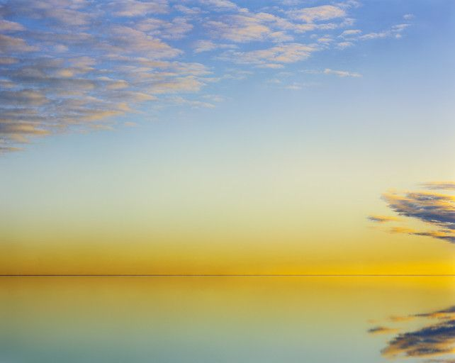 a rare yellow, breaking dawn over lake eyre, australia, by murray fredericks
