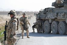 Canadian Grenadier Guards in Kandahar Province standing by road with armoured car. Soldiers from the Canadian Grenadier Guards in Kandahar Province in Afghanistan, pictured, fought with Dutch soldiers against Afghan insurgents.